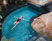 Women on Vacation Floating in Pool